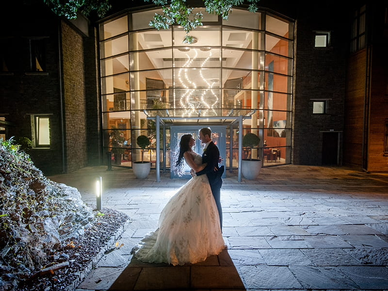 Bride and Groom hugging in front of the Kinsale Hotel & Spa Wedding Venue